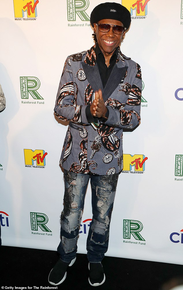 Blue jean baby: Nile Rodgers cut a funky look in a denim suit jacket with a key print, paired with distressed jeans