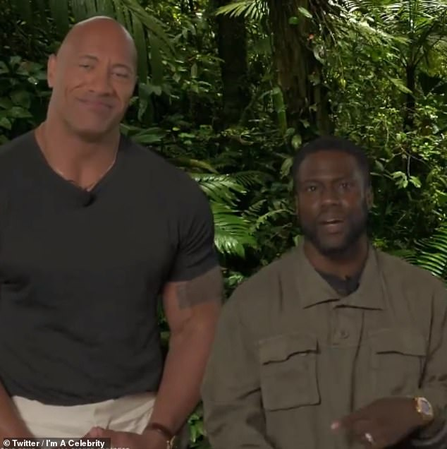 Like a married couple: As Dwayne displays his incredible pecs, Kevin claims:'That is dumb! If anybody's looking for the definition of dumb it's this! Can you put a brain in your pec?'