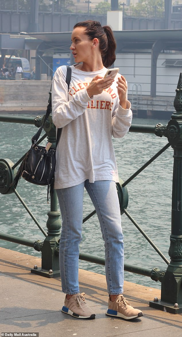 Hazy:After her flight home to Brisbane was cancelled, the 29-year-old revealed the smoke had flared up her allergies as she took in the sights at Sydney Harbour