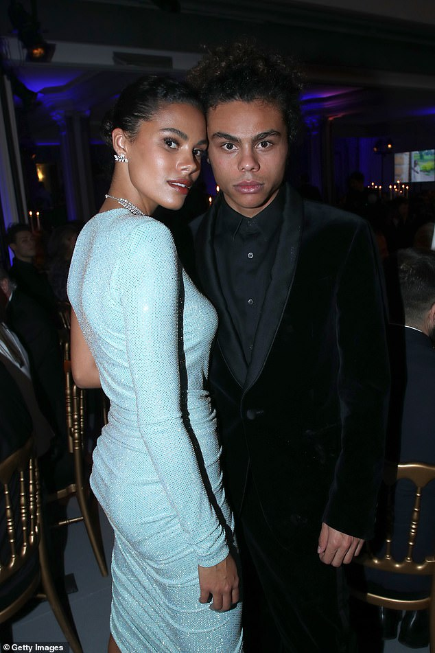 Family:Vincent Cassel's wife Tina Kunakey, 22, who was joined by her brother Zachary