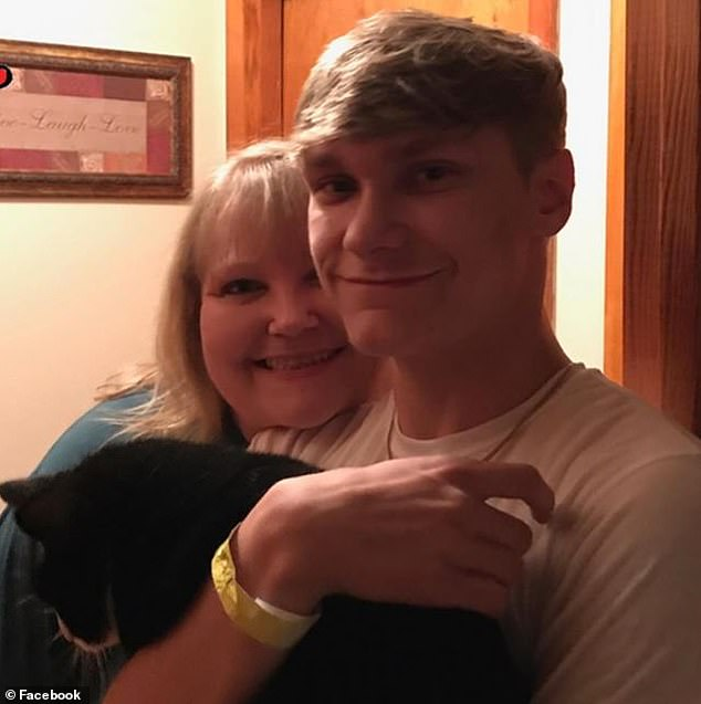 His dorm-mate found Lewis collapsed on the floor with an EpiPen in his hand, and called 911. Pictured: Lewis, right, with his mother