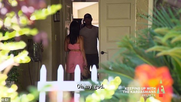 Secret meeting: Kourtney went to the door of a house in her neighborhood as Khloe and Kim spied on her