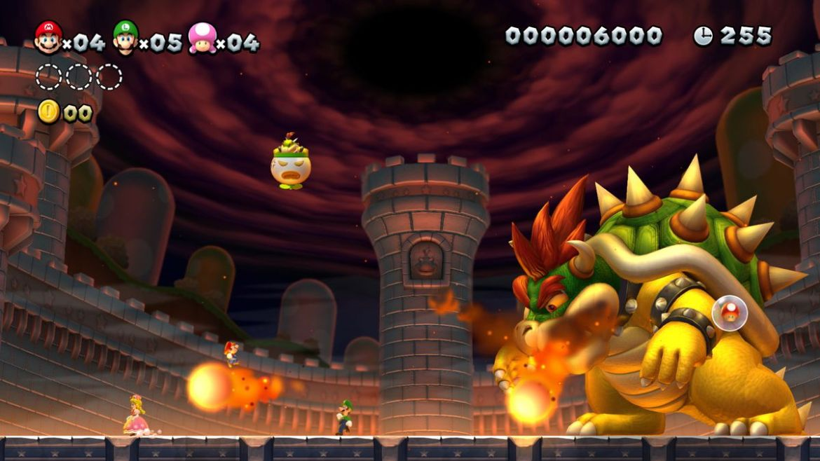 New Super Mario Bros. U Deluxe - Mario, Luigi, and Toadette in boss fight with Bowser