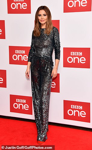 Standing tall:Adding height to her frame, Cheryl stood tall in a pair of quirky metallic platform heels as she graced the red carpet