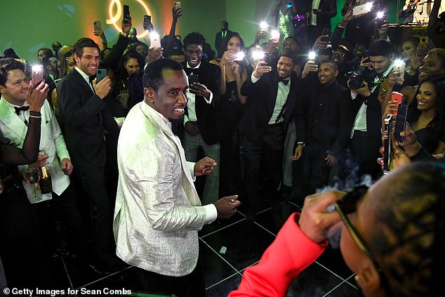 Centre of attention: Diddy and his silver dinner jacket took centre stage as the festivities got under way at his LA mansion