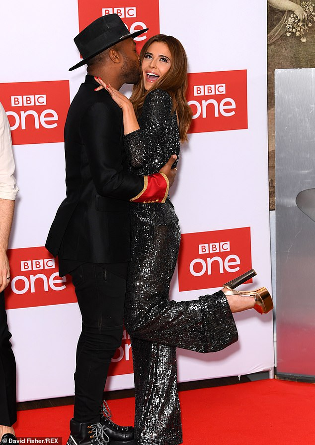 Giddy: Cheryl was on cloud nine as she received a kiss from the show's latest addition - RuPaul's Drag Race choreographer Todrick Hall