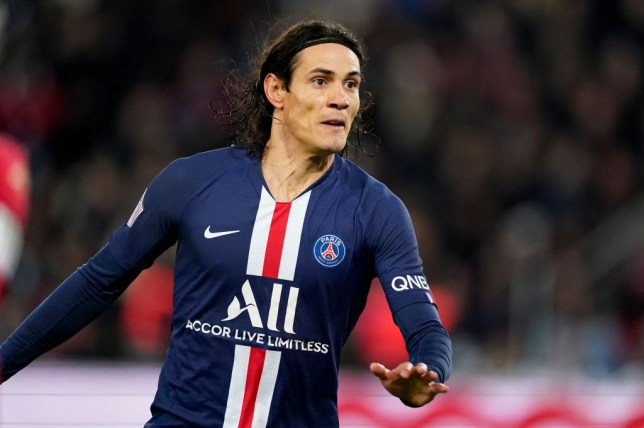 Chelsea and Manchester United transfer target Edinson Cavani looks on while playing for PSG