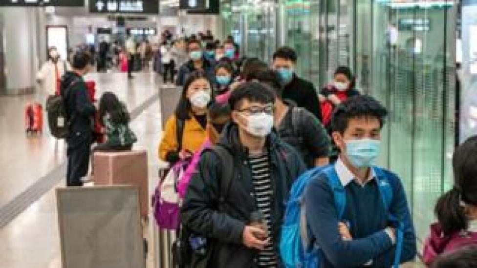 Passengers at a Hong Kong railway station