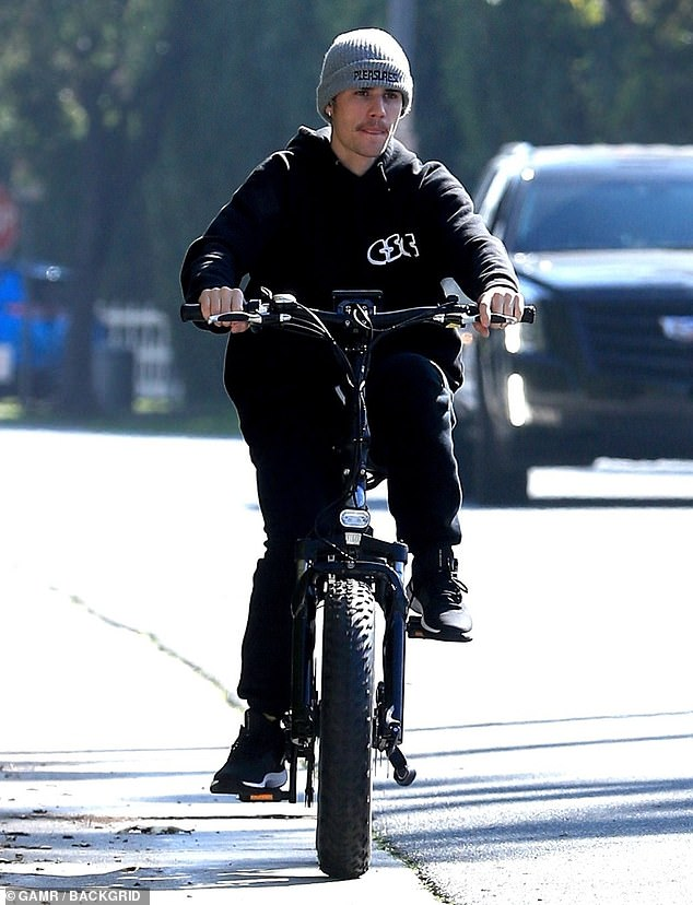 Cruising: Justin Bieber rode his bike around Beverly Hills amid the buzz over his new YouTube docu-series, which came out Monday morning