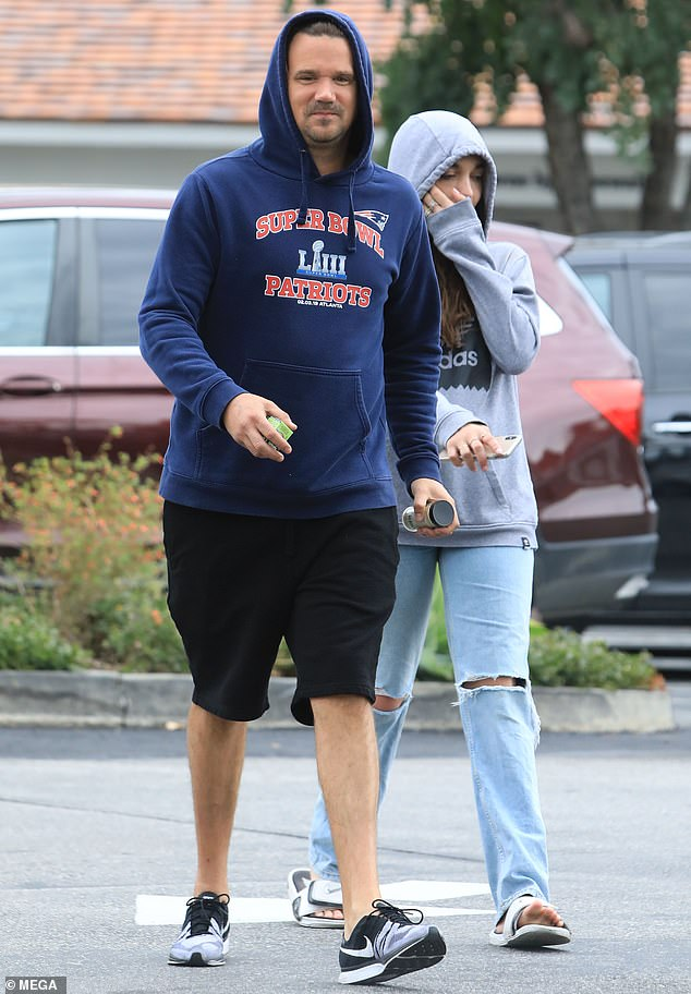 Low profile: Sean Stewart kept a low profile in a blue hoodie as he stepped out for lunch Friday with an unidentified woman in Beverly Hills