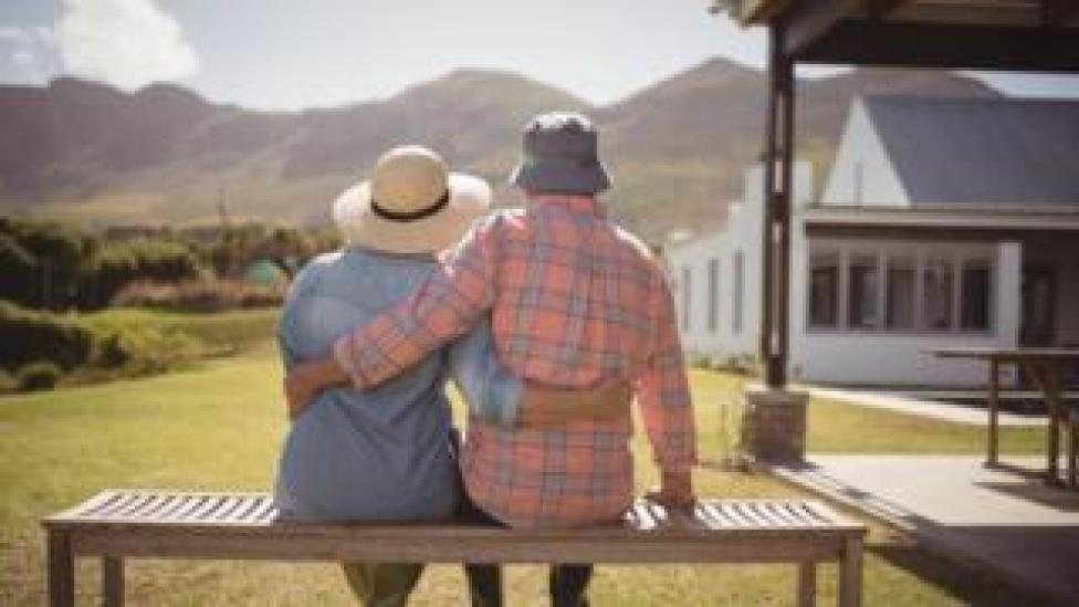 An older couple sitting on a bench