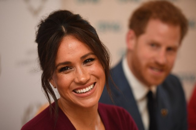 "(FILES) In this file photo taken on October 25, 2019 Britain's Prince Harry, Duke of Sussex (R) and Meghan, Duchess of Sussex attend a roundtable discussion on gender equality with The Queens Commonwealth Trust (QCT) and One Young World at Windsor Castle in Windsor. - Britain's Prince Harry and his wife Meghan will give up their titles and stop receiving public funds following their decision to give up front-line royal duties, Buckingham Palace said on January 18, 2020. ""The Sussexes will not use their HRH titles as they are no longer working members of the Royal Family,"" the Palace said, adding that the couple have agreed to repay some past expenses. (Photo by Jeremy Selwyn / POOL / AFP) (Photo by JEREMY SELWYN/POOL/AFP via Getty Images)"
