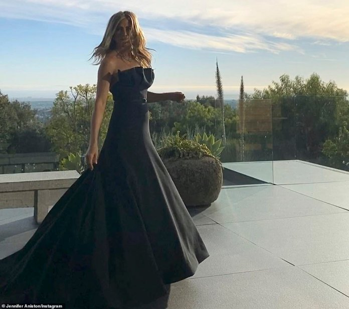 Plush:In the same slideshow, Jennifer shared an image of herself in her Dior gown while posing up a storm on her balcony