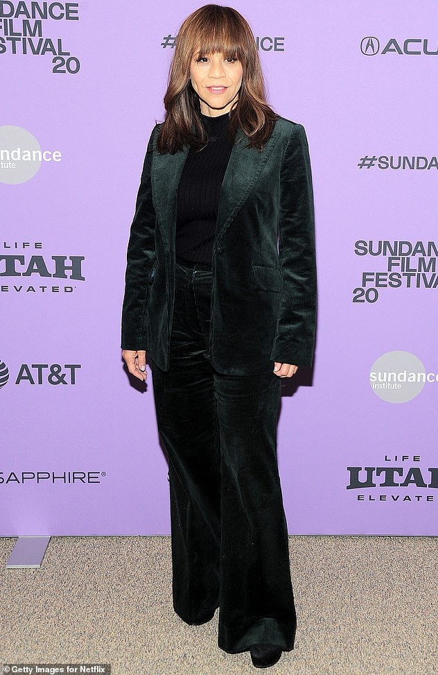 Corduroy chic: Co-star Rosie Perez also opted for corduroy jade pantsuit, paired with a ribbed black sweater