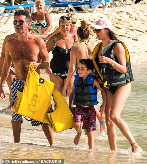 Fun day out: The family were seen larking around on the beach as they walked along the shore, before indulging in some water-sports