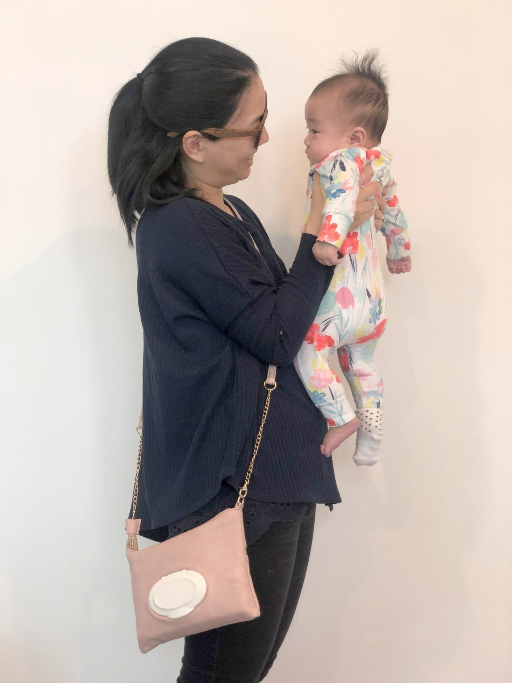 Alicia with Ava wearing the bag