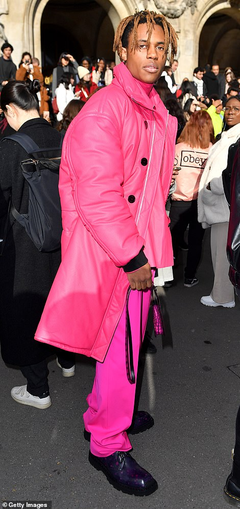 Man on the town: Kailand Morris was also a vision of colour in a neon pink ensemble