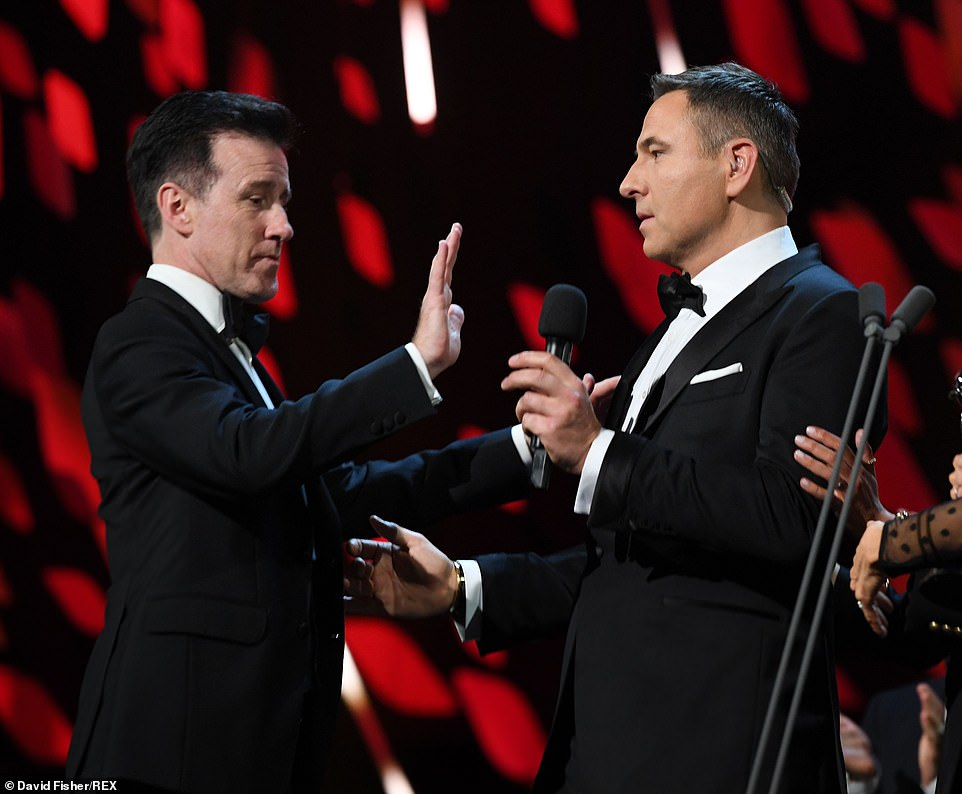 Shall we dance? David soon turned things back to himself. 'Shall I do it next year?' he asked, grabbing Anton Du Beke for an impromptu dance