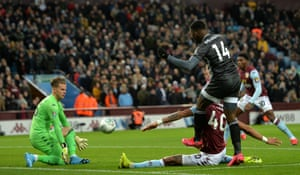 Villa goalkeeper Orjan Nyland blocks a shot by Kelechi Iheanacho.