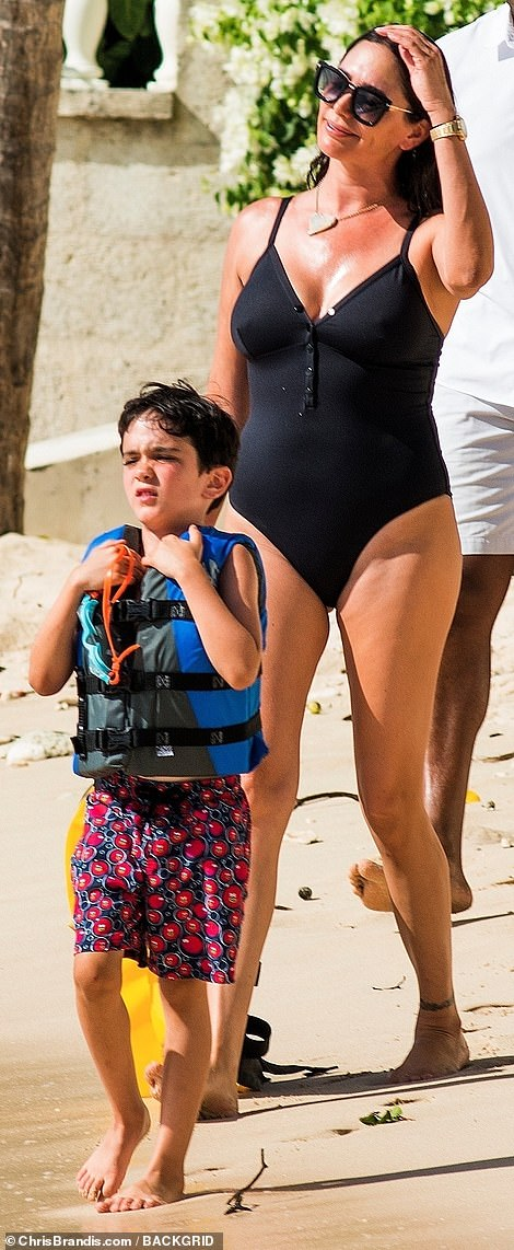 That's my boy: Eric walk ahead of his mother as they prepared for their fun-filled beach day
