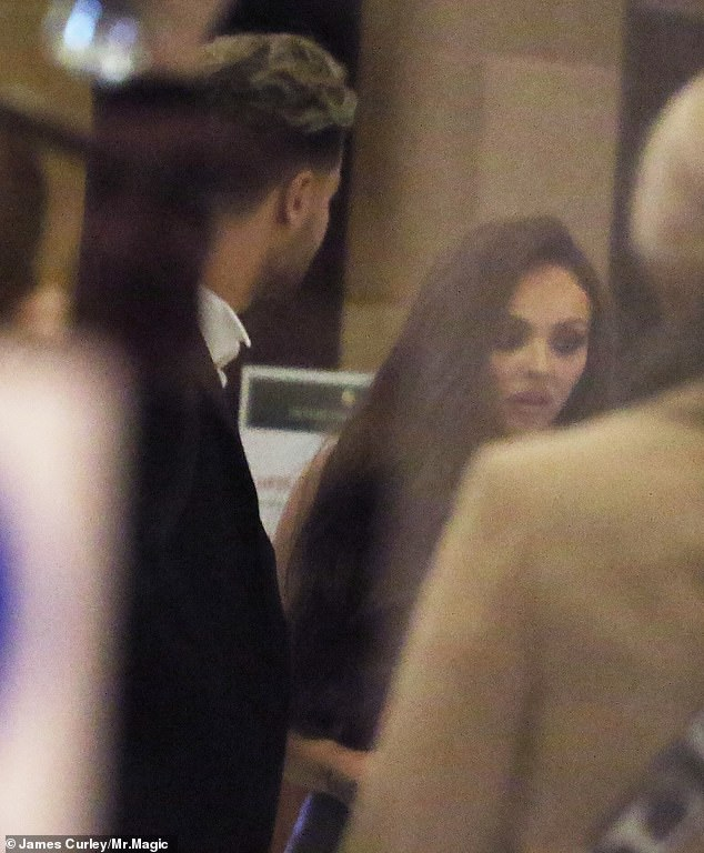 Moments before: Love Island star Chris, 27, is at the centre of a police investigation after he became embroiled in a violent altercation with a photographer after attending the awards with girlfriend Jesy Nelson (above)