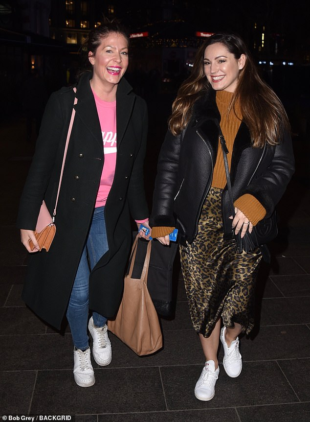 Style: The former glamour model cut a casual figure for the evening, donning a tan jumper with a high-collar as she left with a female pal