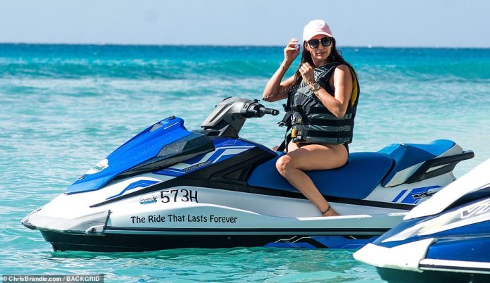 Stunner: The American beauty looked great as she perched on a jet ski