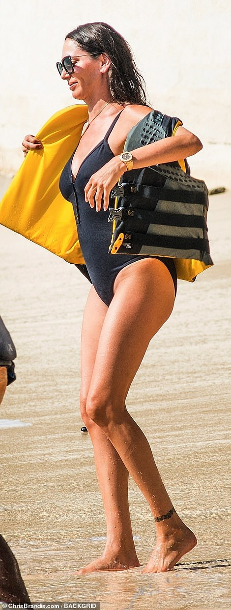 Sensational: The mum-of-two showcased her golden tan after weeks of sunning herself on the Caribbean island