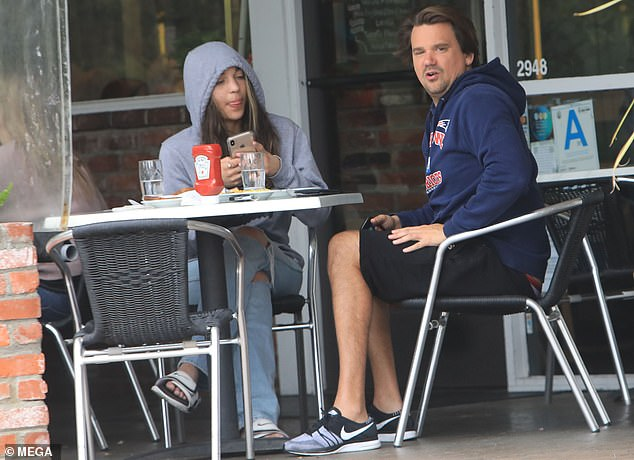 Lunch date: He and his date both kept their hoods up over their heads as they arrived at Beverly Glen Deli