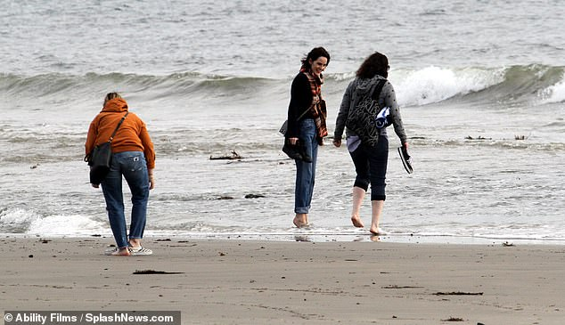 Delight: Michelle took a dip in the freezing waters during the blustery day