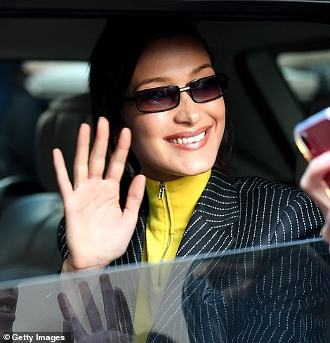 Pretty: She finished her chic look with narrow-framed sunglasses