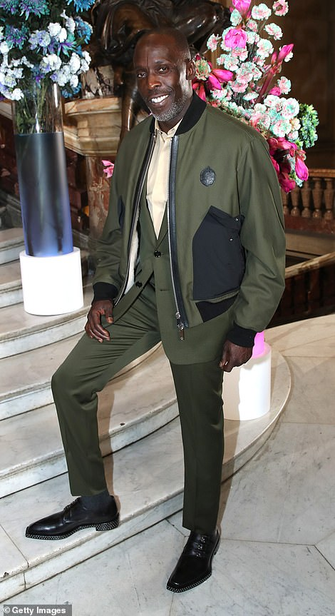 Dressed up: Actor Michael K. Williams was also looking sharp in olive green