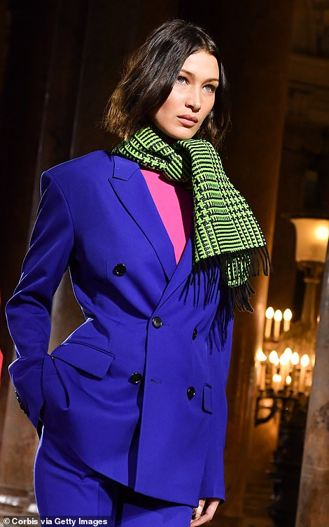 Stylish: The model looked sensational in her colourful co-ords as she walked in theBerluti show for Men's Fashion Week in Paris