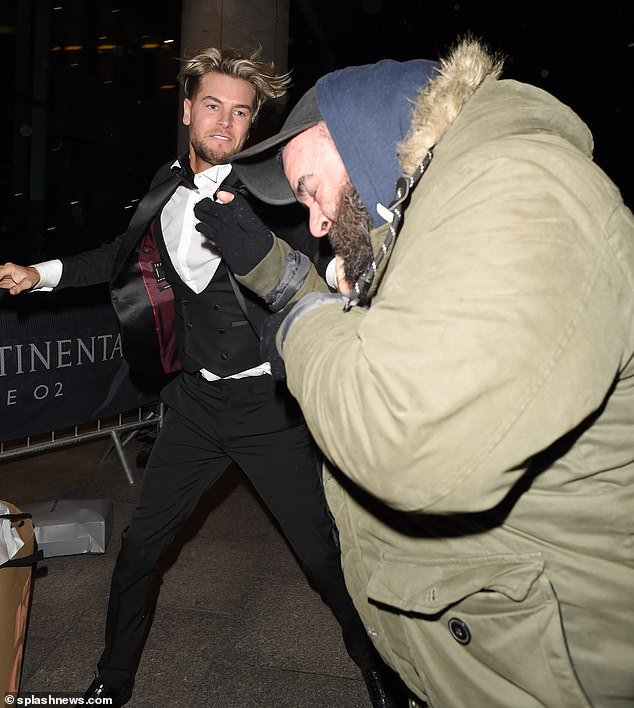 Shock brawl: Chris found himself grappling with a photographer outside the O2 in the early hours of Wednesday morning, in a row which is now being investigated by the Met Police