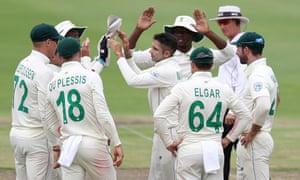 South Africa's Keshav Maharaj celebrates taking the wicket of England's Jos Buttler.