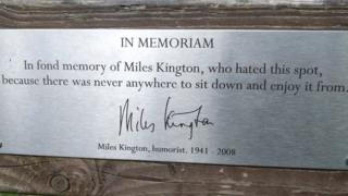 "Bench dedication: ""In fond memory of Miles Kington, who hated this spot, because there was never anywhere to sit down and enjoy it from."""