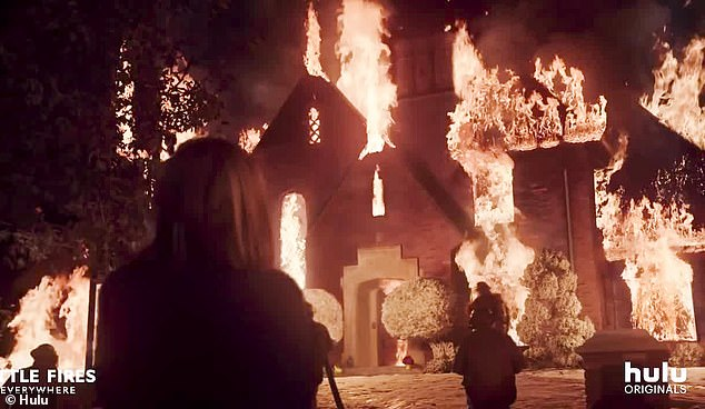 Ablaze:The clip opens with a horror-stricken woman (Reese ), who watches her lavish home go up in flames