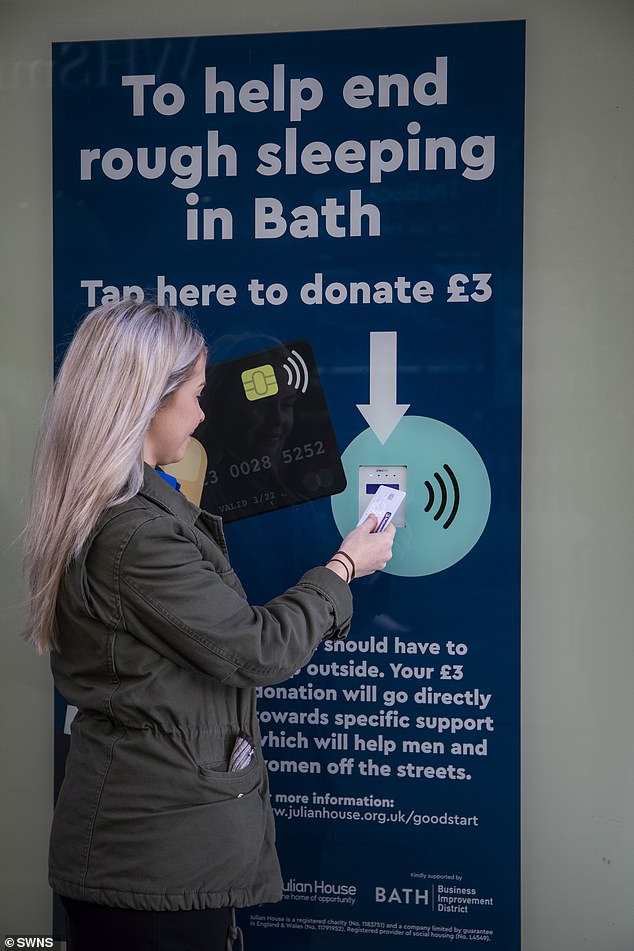 Each tap to the window's contactless card reader donates three pounds towards homeless people in the area, with users able to tap multiple times per visit