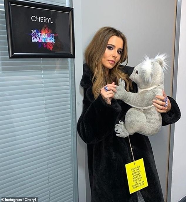 Helping: Ahead of the show, Cheryl shared a snap with a koala bear teddy to raise awareness of the Australia wildfires