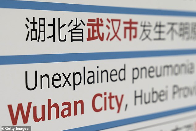 Some 1.4billion Chinese citizens will be travelling abroad during Lunar New Year. Pictured, a notice for passengers from Wuhan is displayed in Japan, where one case has been detected