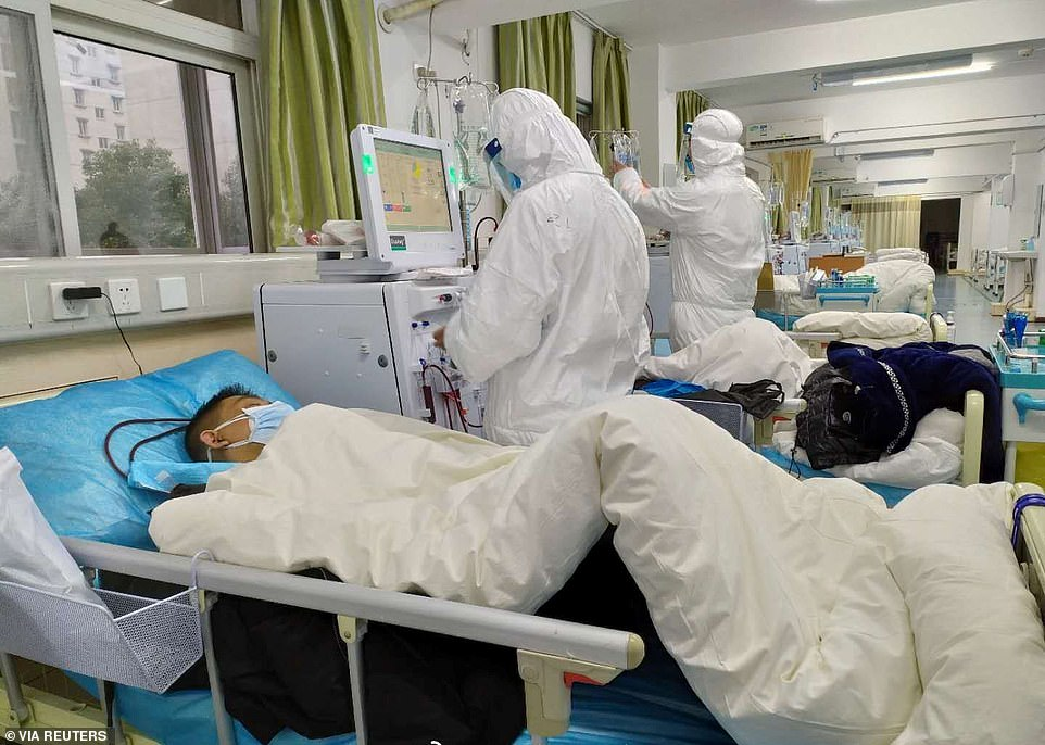 On Tuesday, the WHO said China was finally allowing international experts to visit 'as soon as possible.' Pictured: Patients undergo treatment at Wuhan Central Hospital on Saturday