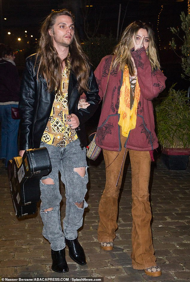 Hippie chic: The California native, 21, wore brown leather, or possible suede, pants that hugged her hips and upper legs and flared at the bottoms in a 1960s design