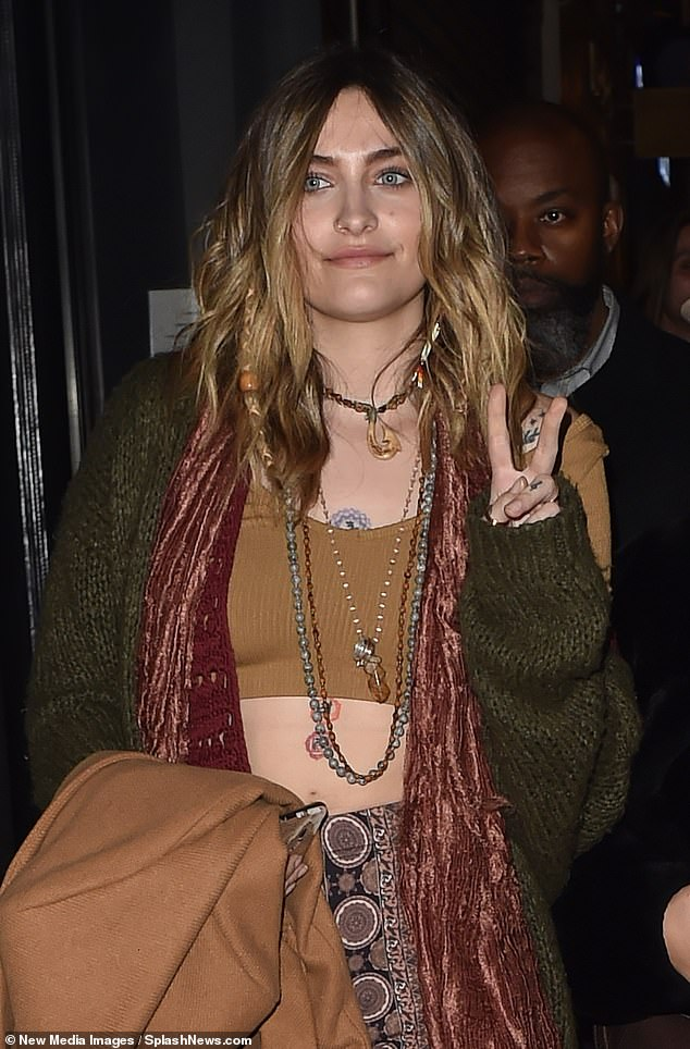 After the show: After Paris walked the show she was seen heading out of the studio. The star was decked out in her normal boho style with a knitted green sweater over a brown cropped tank top with layers of necklaces and her tattoos showing