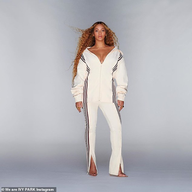 Angelic: In one stunning shot, Beyoncé models the predominantly white Adidas x IVY PARK tracksuit that features the iconic three stripes in maroon