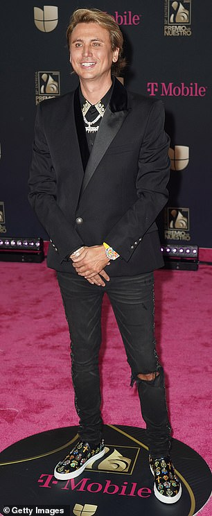 This is dressy for him: He had on a tuxedo jacket and ripped jeans