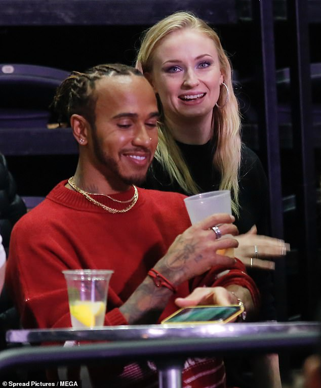 Night out: The Game Of Thrones star, 24, looked animated as she chatted to the F1 racing champion during the Jonas Brothers gigs at the Accor Hotels Arena in Paris