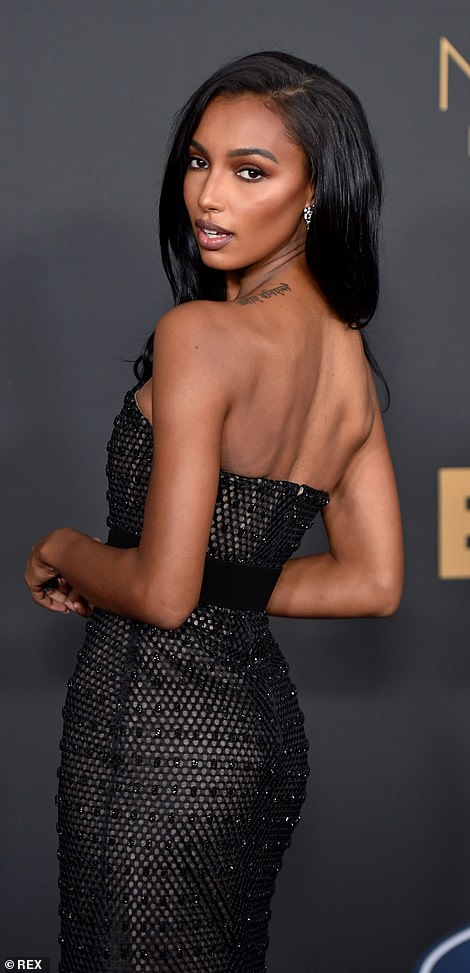 The strapless dress gave an unfettered look at Jasmine's shoulders, one of which appeared to bear a Sanskrit text tattoo