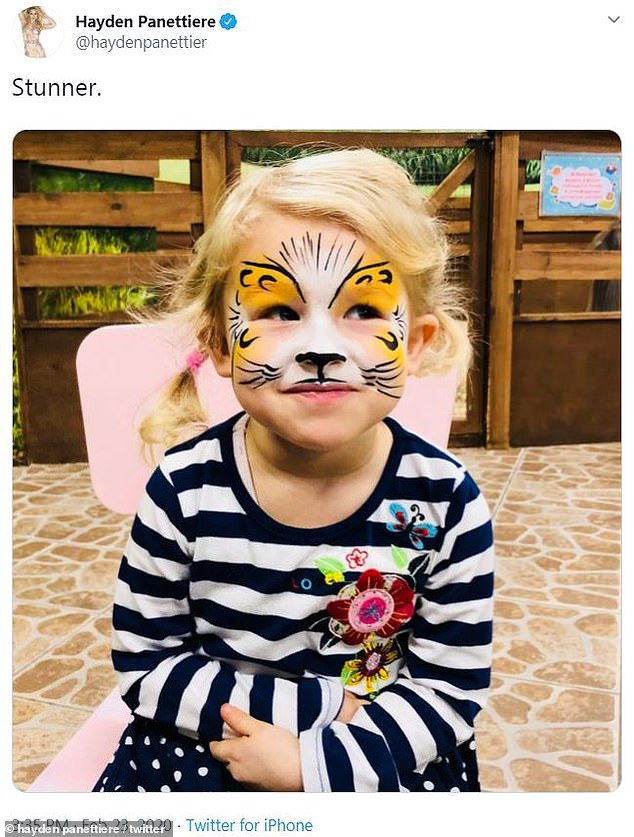 Roar:Kaya, who lives in the Ukraine with her father, had tiger-like features painted on her face as she smiled
