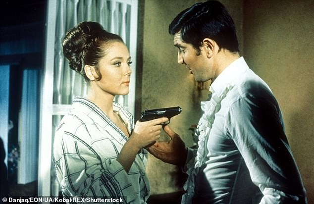 Iconic role! If you fancy an autograph with the On Her Majesty's Secret Service star, it will add a further $60 to your costs. Pictured with co-star Diana Rigg (left)