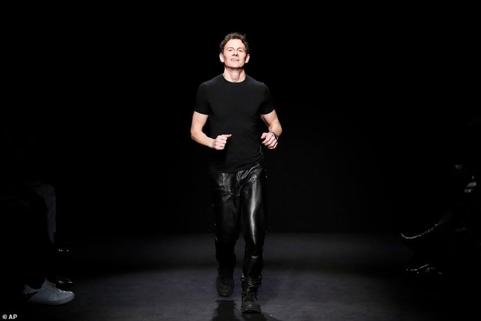 Larking around: Mugler's creative director Casey Cadwallader rounded on the crowd following the showcase, while sporting a fitting pair of leather trousers and a tight black top